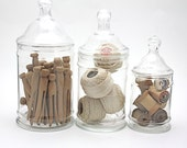 three apothecary jars filled with clothespins wooden spools tatting thread instant collection