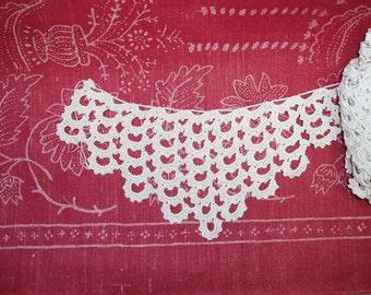 Cream hand crochet fringe lace.
