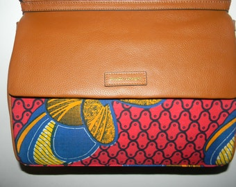 Tribal print and leather fashion handbag in red and brown