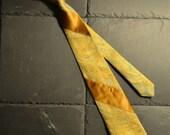 Golden necktie with woven flowers