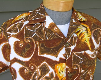 vintage 1960's Hawaiian short sleeve shirt . Tribal batik with fish & shells. Very Funky. Small Medium