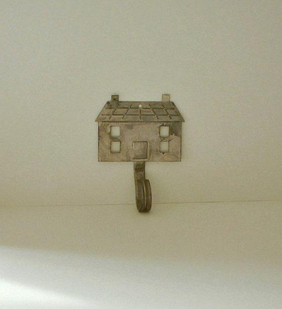 Rustic HOUSE Wall Hook. Metal. Pressed Tin. Vintage.Primitive. Small. Has hanging hole.
