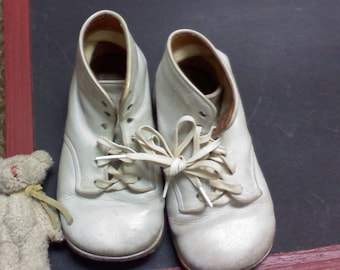 vintage white little baby walking shoes