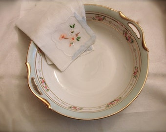 vintage hand painted porcelain nippon bowl with floral design with pastel blue and gold color trim