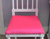 Neon pink and white antique chair