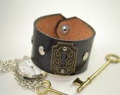 Black Leather Cuff Bracelet with Key Hole Charm and Silver Studs