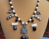 REDUCED From 75.00 - Bib Style Necklace in Black, White and Shades of Gray