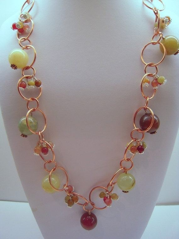 Serpentine Beads Swing from a Copper chain