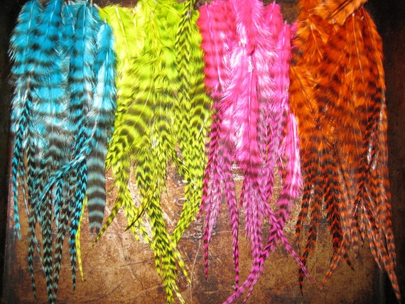 More than 100 loose feathers for jewelery making or hair extensions or crafting