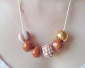 Sand Dollar: Ceramic Bead Necklace
