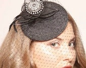 Cecily Black fascinator with sinamay flower, goose feather and vintage look brooch