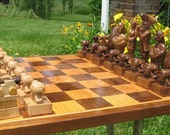 Chess Set Jolly Roger Band Chess Set on etsy handcarved  custom chess sets, custom chess pieces, and custom chess boards