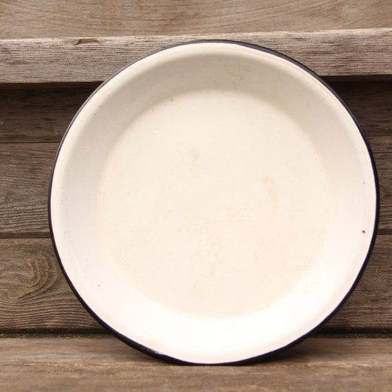 White with black rim enamelware pie plate