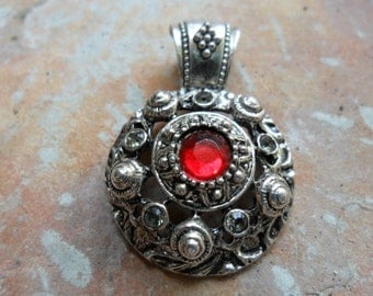 Ornate Round Pendant -Silvertone with Red Rhinestone
