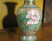 green cloisonne' vase, white flower on brown background
