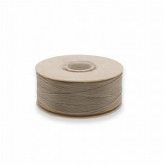 Nymo D 0.30mm Sand Ash. Sold by package of 2 bobbins.