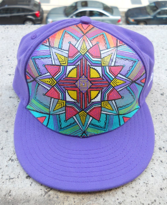 Purple Flat Brim hat with a hand painted Zia symbol and sacred geometry