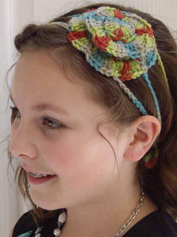 Crocheted - Multi-colored red, green, blue, tanish-gray crocheted flower 3 strand headband