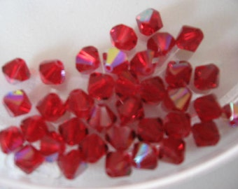 Swarovski Siam Red AB Article 5301 Bi-cones 5mm Qty - 27 ONLY LOT