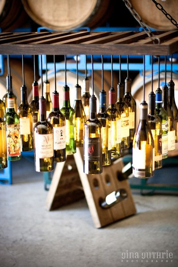 30 wine bottle light chandelier hanging from wood riddling. Black Bedroom Furniture Sets. Home Design Ideas