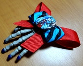 Monster High (Inspired) Ghoulia Yelps Skeleton Hand Hair Clip with Blue Zebra Print and Primary Red  Layered Bows