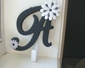 "Wall letter ""A"" with hook, black and white with flowers"