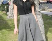 1950s Classic High-waisted 1950s grey skirt.