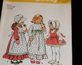 Uncut Holly Hobbie girls dress patterns size 2 with bonnet and apron Simplicity 6635