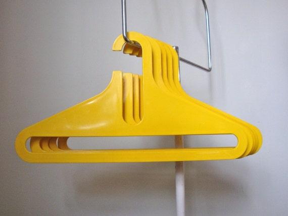 Set Of Five Vintage Yellow Coat Hangers