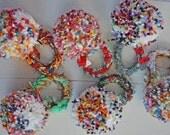 wool blend giant Confetti Firework Pom Pom Corsage on crochet cuff wristlet