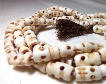 Bone beads - Little Skull Beads Shrunken Heads (10)