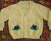 Child's yellow bunny Vee neck cardigan.