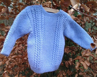Girl's childs toddlers mauve aran cable hand knitted sweater jumper with shoulder buttons