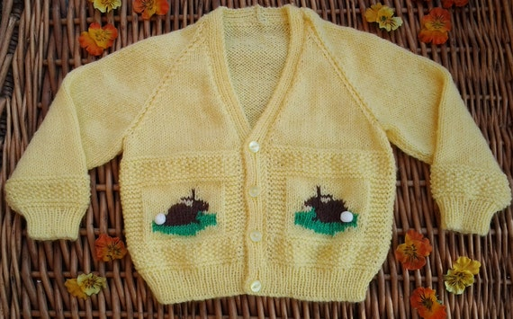 Child's yellow bunny Vee neck cardigan.