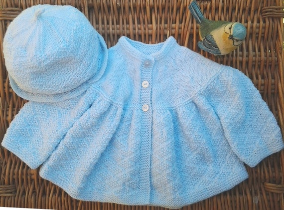 Baby's traditional pale blue Diamond matinee jacket and hat set. Diamond Jubilee inspired.