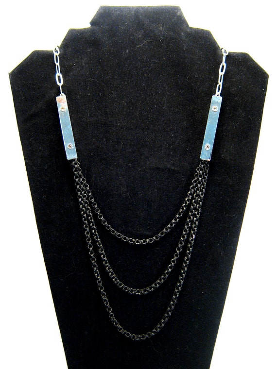 Modern statement necklace, black and silver tone, screws