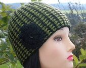 Knitted ladies hat pretty in two toned guava and black  with crochet flower