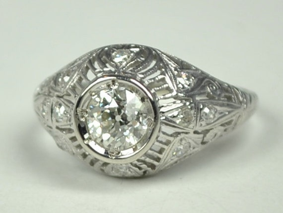 Art Deco Platinum Ring with a .68 Carat Center Stone. A Delightfully Gorgeous Ring!