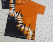 Tie dye YOUTH SMALL shirt  - Track of orange and black-  Other sizes can be dyed and shipped within a week- 200