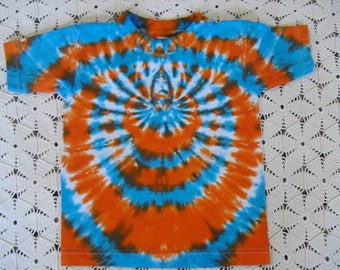 Tie dye 4 Toddler tee shirt spidered in turquoise, orange, and bronze