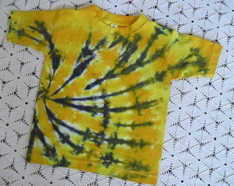 Tie dye 4T and Youth Small shirts swirled in yellow & black are ready to ship today.  (Other sizes will be dyed/shipped within a week.)