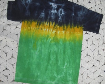 Tie dye youth small shirt in a dragon green, gold, and black track (Other sizes can be dyed and shipped within a week.)