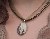 Emergence I glass pendant with detail of orchid fairy watercolor on dark green organza ribbon necklace