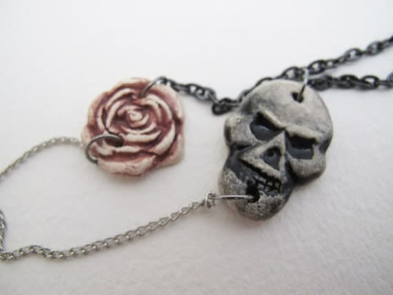 Necklace, ceramic rose and skull on silver and gunmetal chain
