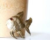vintage golden fish brooch  B.S.K