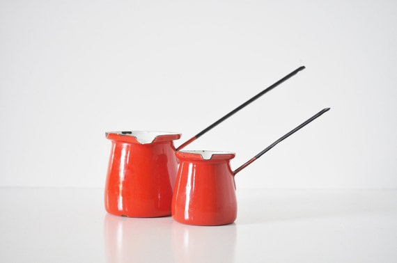 Pair of Red Enamel Pitchers