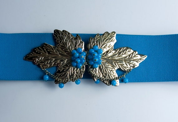 1970's stretchy turquoise and gold maple leaf clasp belt
