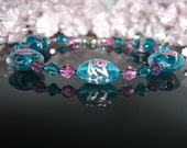 Blue Zircon and Rose Glass Coin Bead and Crystal Bracelet
