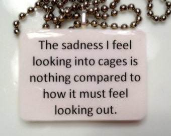 The Sadness I feel looking into the cages is nothing compared to how it must feel looking out     Game Tile Pendant