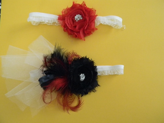 2 garter set Ivory, red and black.  Black, red flowers, rhinestone. Curled red feathers, black feathers, & Ivory tulle.  One size fits most.